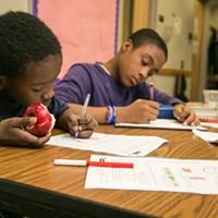 SWAN After-School Program Zhymeer & Semaj doing homework. PHOTO BY MIKE HANLON