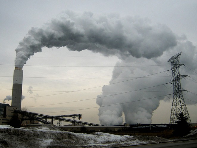 Emissions billow out of a smokestack. - VIA FLICKR USER RIBARNICA