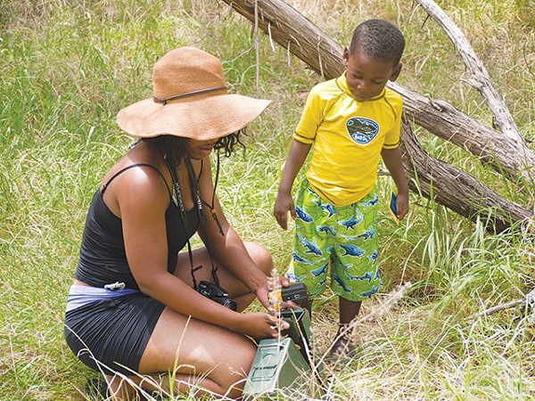 A family finds a geocache in one of Texas' many state parks - COURTESY PHOTO
