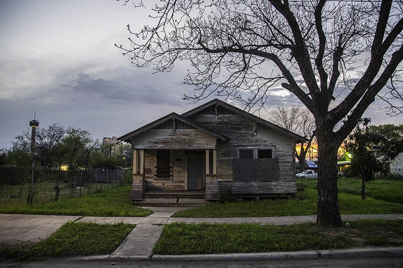 Abandoned houses  such as this one on SA's East Side are being sold at a feverish pace. - J. MICHAEL SHORT