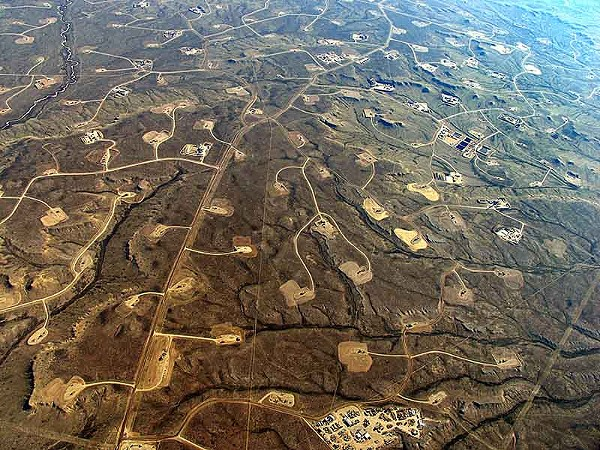 An aerial perspective of the fractured landscape in Wyoming, where more than 1,000 wells have been abandoned - ECOFLIGHT