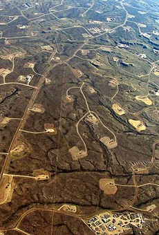An aerial perspective of the fractured landscape in Wyoming, where more than 1,000 wells have been abandoned
