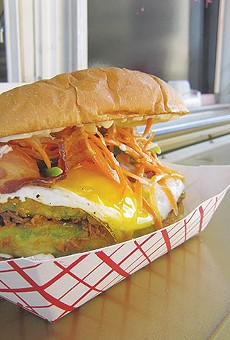 An ooey-gooey egg finishes this American banh mi
