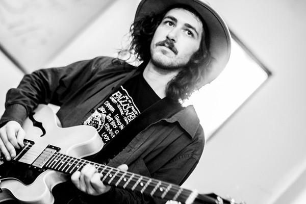 Andrew Suhre of Creatura and Antinque Sunlight with his Epiphone guitar, which was stolen in January. - COURTESY