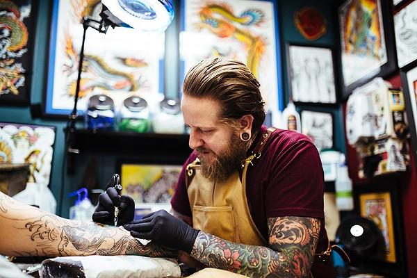 Artist and shop owner Jedidia Reid at his Element Tattoo Studio. - JOSH HUSKIN