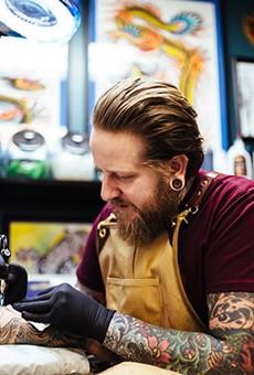 Artist and shop owner Jedidia Reid at his Element Tattoo Studio.