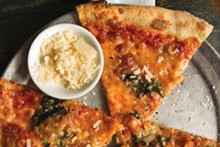 Barbaro's pizza with taleggio, hash browns, kale and honey - ANA JENKINSON