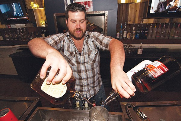 Bartender Chad Buckley mixes it up at Redland Roadhouse. - STEVEN GILMORE