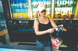 Bartender Meagan Ochoa mixes a drink at Wxyz Bar in the Aloft Hotel.