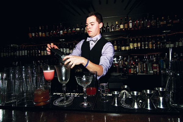 Bartender Stephan Mendez shakes and stirs at 1919. - MIKE BARAJAS