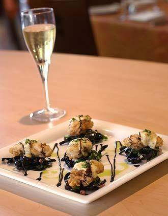 Biga on the Banks' chicken fried oysters atop squid ink linguini, Swiss chard, pancetta and mustard hollandaise.