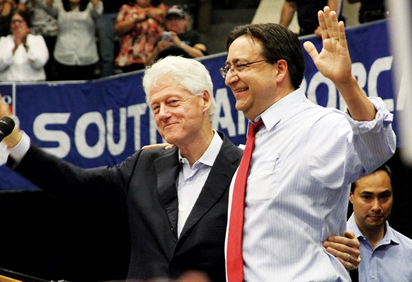 Bill Clinton and Pete Gallego at South San High School. Photobomb by Joaquin Castro. - MICHAEL BARAJAS