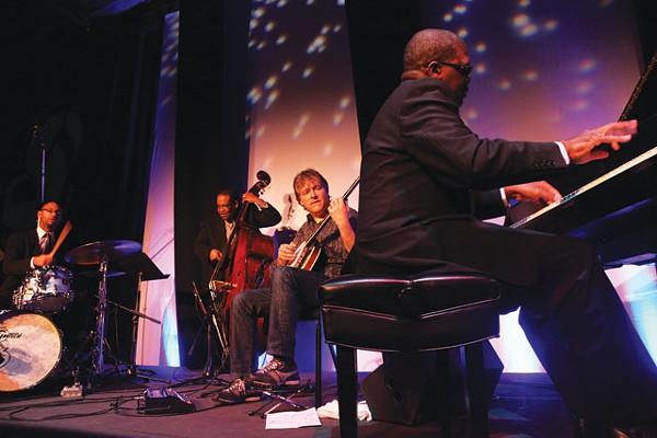 Burnin' one: Béla Fleck (center) and the Marcus Roberts Trio. - COURTESY PHOTO
