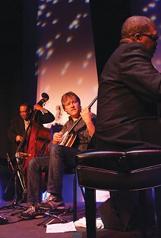 Burnin' one: Béla Fleck (center) and the Marcus Roberts Trio.