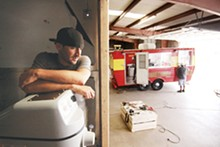 FILE PHOTO - Cameron Davies, of Boardwalk on Bulverde, at his truck outfitting biz Cruising Kitchens