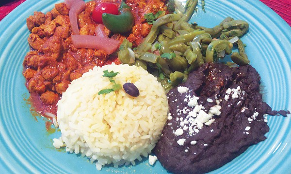 Cascabel's Cochinita pibil, served with white rice and black beans - SCOTT ANDREWS
