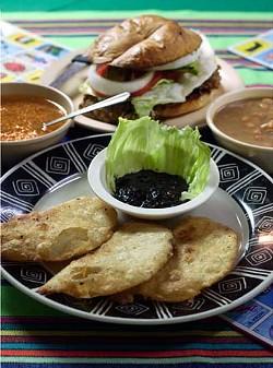 Cascabel's quesadillas de huitlacoche and a milancesa torta flanked by bowls of frijoles de la olla and sopa de fideo.