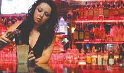 Chelsea Brooks keeps the glasses full at Chango's Havana Club.