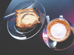 Coffee cake and a macchiato keep each other company at Jupiter.
