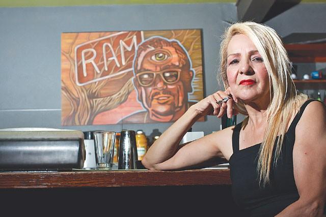 Cruz and a portrait of Ram by Robert Tatum at Limelight. - STEVEN GILMORE