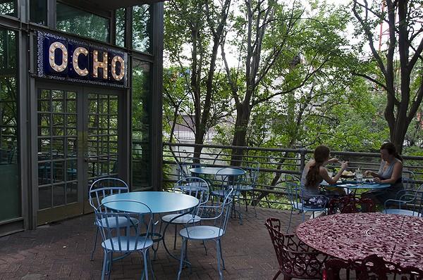 Cubano fun at Ocho, with Spot in tow. - ALLISON V. SMITH