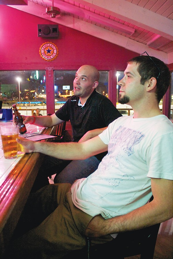 Daniel Arsenault and John Ford have a relaxed brew at Wurzbach Ice House.