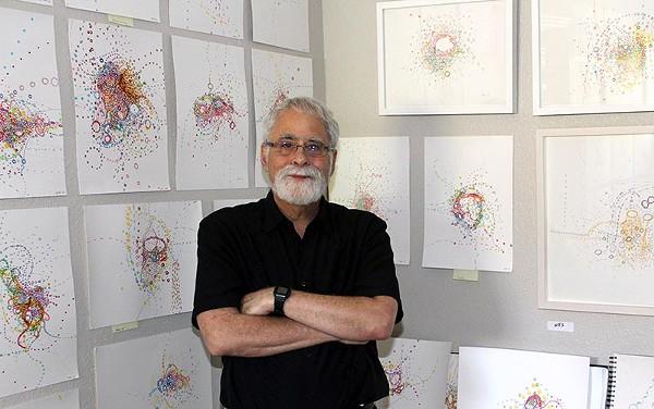 "David Rubin among his stacks of ""automatic drawings"" - COURTESY"