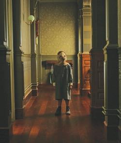 (Dead) kids in the hall: A ghost haunts El Orfanato.
