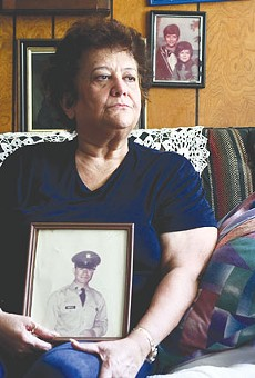 Decades of struggle: Diana Quintanilla Montoya holds a photo of her husband.