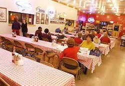 Diners enjoy their BBQ in the indoor dining room at Rudy's Country Store and Bar-b-que in Selma on a recent Thursday evening.