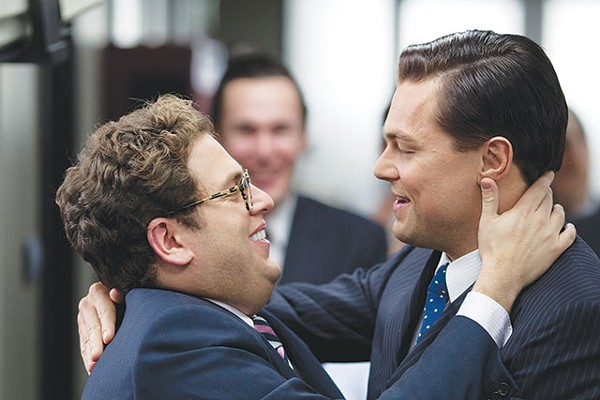 Donnie Azoff (Jonah Hill, left), the first loser turned millionaire by Jordan Belfort (Leonardo DiCaprio) in 'The Wolf of Wall Street' - COURTESY PHOTO