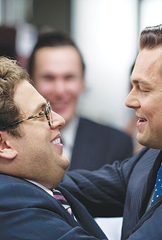 Donnie Azoff (Jonah Hill, left), the first loser turned millionaire by Jordan Belfort (Leonardo DiCaprio) in 'The Wolf of Wall Street'
