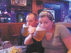 Dr. Ellington and Dr. Adams demonstrate the awesomeness of Rascals' $3.50 mini pitchers.