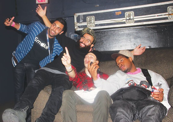 Fan poses with Das Racist's Victor Vasquez and guest rappers Lakutis and Houston's Fat Tony. - PHOTOS BY NATALIA CIOLKO