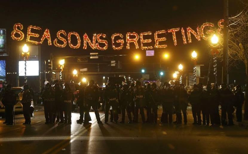Law enforcement wearing riot gear in Ferguson, MO on Monday, November 24, 2014. Protesters clashed with police following the announcement that a grand jury decided not to indict Officer Darren Wilson for the fatal shooting of Michael Brown.