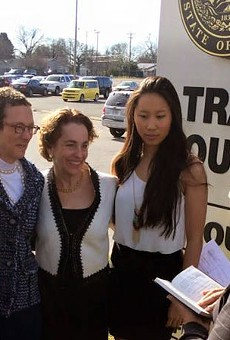 Sarah Goodfriend and Suzanne Bryant, shown here with their daughters Dawn and Ting, became the first same-sex couple to be legally wed in the Sate of Texas on Thursday.