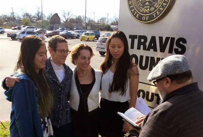 Sarah Goodfriend and Suzanne Bryant, shown here with their daughters Dawn and Ting, became the first same-sex couple to be legally wed in the Sate of Texas on Thursday. - TWITTER