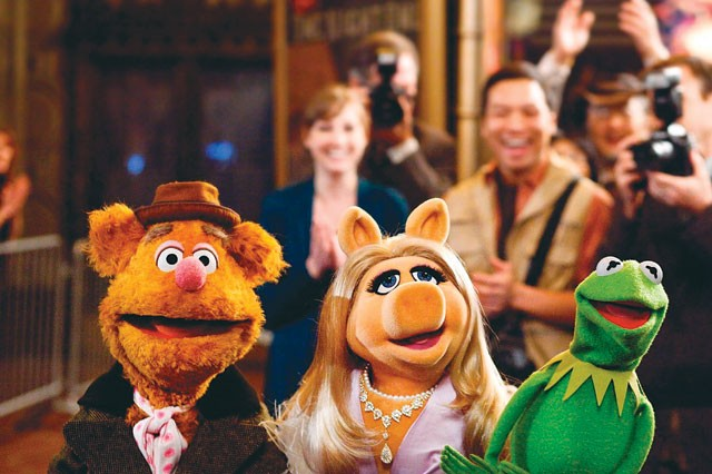 Fozzie Bear, Miss Piggy, and Kermit the Frog return to the big screen in The Muppets. - COURTESY PHOTO