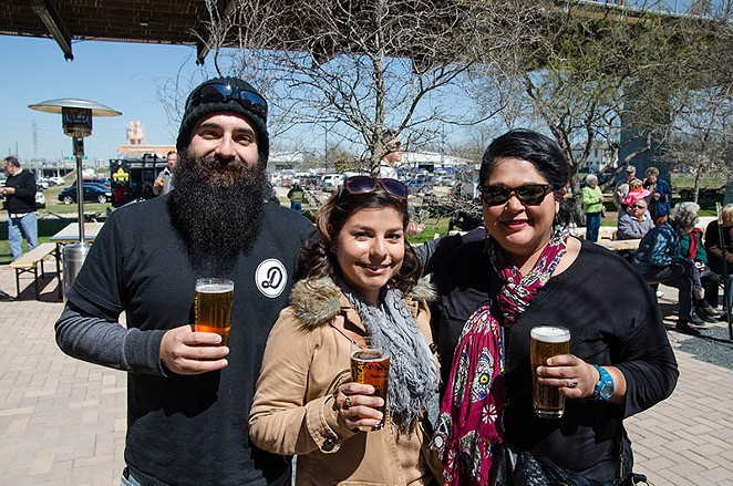 Friday day drinkers are converging at the Alamo Beer Co. Brewery for first day of the Legendary Grand Opening Weekend. - JAIME MONZON