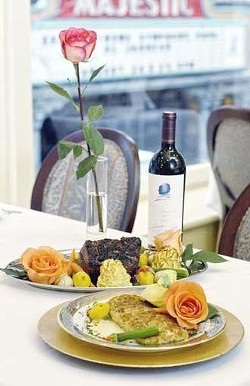 "From front: pistachio-encrusted red snapper and the Chateau Briand """"for two,"""" carved tableside, and served with mashed potatoes and vegetables."