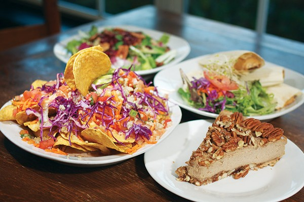 From left: Veggie Nachos, Oh-My-Not-So-Honey Quinoa Salad, Homemade Vegan Tamales, and Raw Apple Spice Pecan Cheesecake from Vegeria. - STEVEN GILMORE