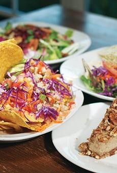From left: Veggie Nachos, Oh-My-Not-So-Honey Quinoa Salad, Homemade Vegan Tamales, and Raw Apple Spice Pecan Cheesecake from Vegeria.