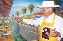 SCOTT ANDREWS - George Cortez pointing towards the present location of Museo Alameda on a painting depicting his dreams for Market Square, painted 20 years ago.