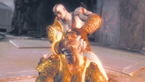 God of War III's Kratos, tearing off the head of Helios, the sun god.