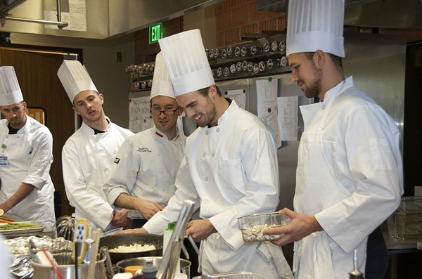 Chef Matthew Davis of the H-E-B Cuiinary Academy leads players of the San Antonio Rampage hockey team in a culinary boot camp. - HANNAH SHOUP