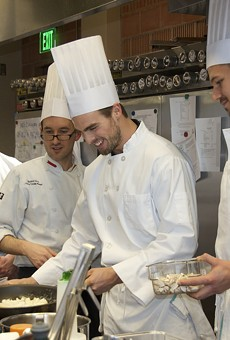 Chef Matthew Davis of the H-E-B Cuiinary Academy leads players of the San Antonio Rampage hockey team in a culinary boot camp.