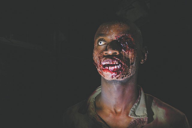 """I eat some brains down in Aaaaaaafrica!"" A zombie (and possible Toto fan) from The Dead. - COURTESY PHOTOS"