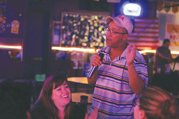 John Burwell sings to Dr. Shaver and the rest of the Scientists at Hidden Tavern. - CHUCK KERR