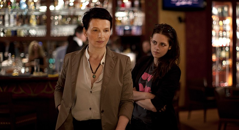 Juliette Binoche (Maria Enders) and Kristen Stewart (Valentine) have an oddly compelling dynamic in Clouds of Sils Maria.