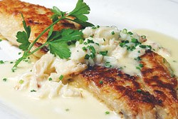 Lemon-butter sauteed snapper topped with Jonah crab claw meat at Wildfish Seafood Grille.